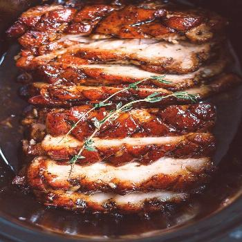 Slow Cooker Pork Belly with Honey Balsamic Glaze - Fall-apart tender and infused with a sticky tang